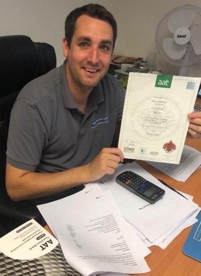 Apprentice Simon Barnard displays his AAT Level 3 Certificate